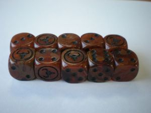 Beastmen Dice. The challenge was to incentivise product purchase upon release, so a single dice was given away with the new release product... until they ran out!